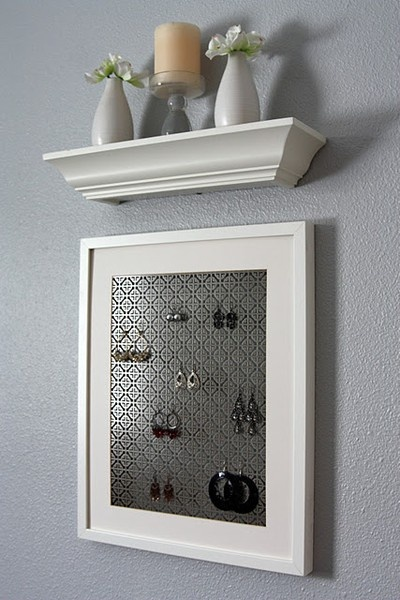 Earring board made out of a picture frame and a radiator cover from home depot. Ive made one and its hanging in my room - I love it!