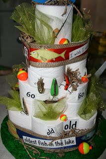Keena Krafts fisherman cake made out of tolate paper.