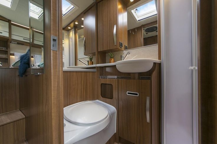 Inside the Hymer ML T580 luxury campervan: Spacious shower and toilet. A shower screen separates the two. Feel free to use this image but give credit to http://smartrv.co.nz/motorhomes-for-sale/german/hymer/ml-t-580-4x4