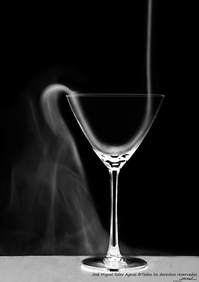 Smoke pouring out of a Martini Glass, black & white photo.