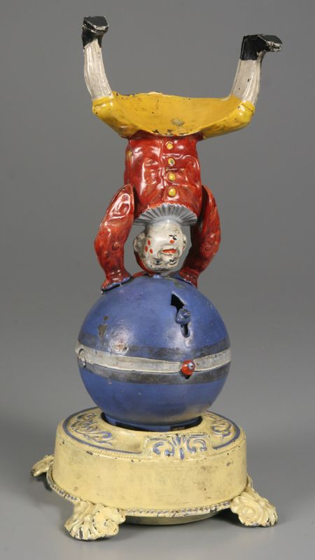Circus Banks - Antique Mechanical Bank, Clown on Globe, J and E Stevens Company, c.1885 - 1900.