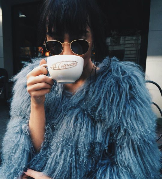 Coffee time in the most stunning faux fur coat and Ray Ban round sunglasses