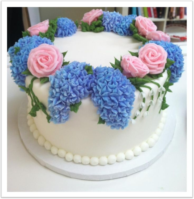 Spring Cake... I wanna learn to make icing lilacs like that.