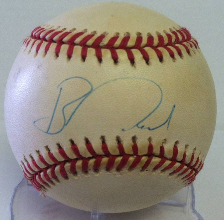 Ben McDonald Autographed Baseball. This baseball has yellow spotting and is sold as is..