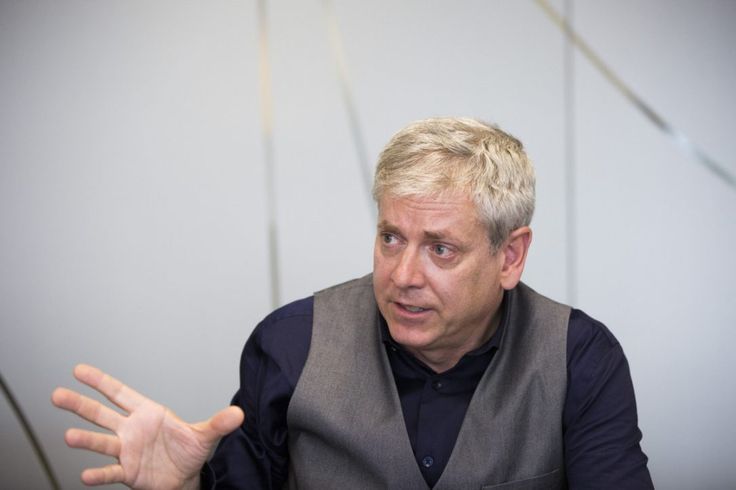 In this image, Charlie Angus, speaks to The Star's editorial board about his political platform. Charlie's body langue is very expressive which demonstrates his genuine passion and belief in his platform which is most likely why this image was chosen.