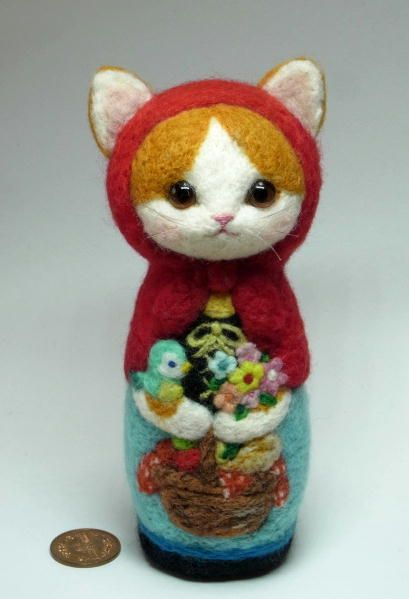 "Needle felted babushka cat a/k/a/ Russian Matryoshka dolls. From the ""It's a small world"" collection of Japanese felting artist Rika Fujimoto."