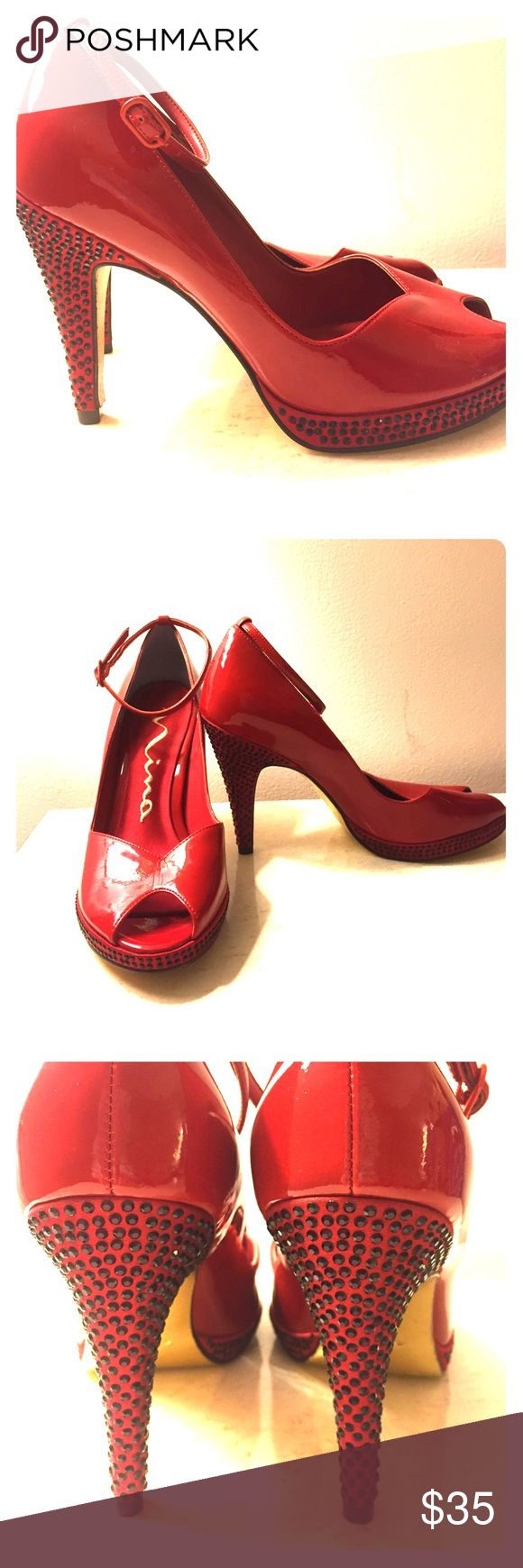 Nina red rhinestone pumps Nina red rhinestone pumps. Patent leather with black rhinestones. Pretty gold sole. Do not believe these were ever worn. Beautiful shoes! Nina Shoes Heels