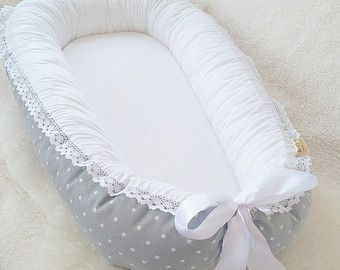 Please always check the processing time. ..................................................................................... The babynest is made with safety in mind. It is recommended by midwifes and infant specialists in Scandinavia. The idea is to replicate your babys experience of close environment, just like in the mother womb and making your babys transition to the new world smoother. The babynest can be used in bed between the parents to avoid suffocation. It is easy to carry along…