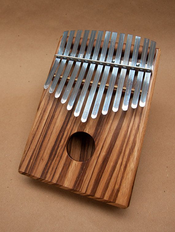 this is a kalimba. It sounds so relaxing and it will can be my first instrument