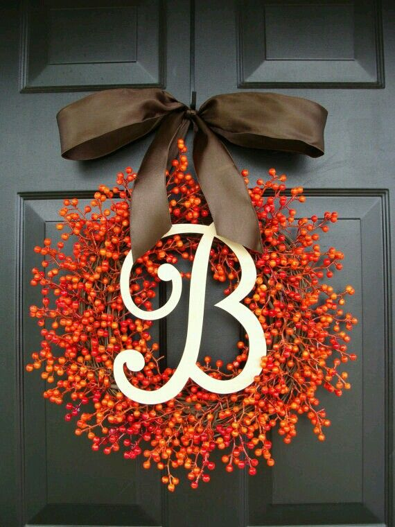 Make it red instead for Christmas. Fall Decor - Monogram Berry Wreath. With a different bow, I would love this.