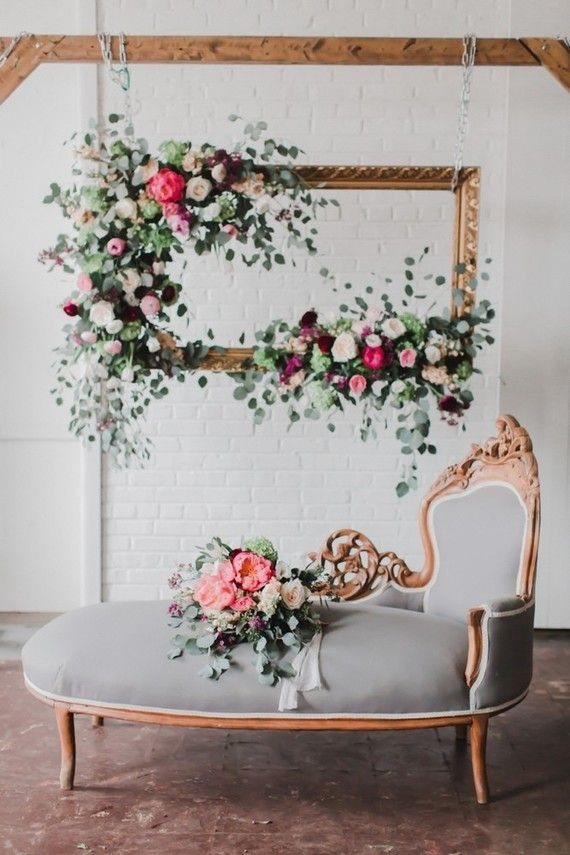 Beautiful idea for a photo station. Like a rustic or gilded frame with patina, augmented with flowers and leaves