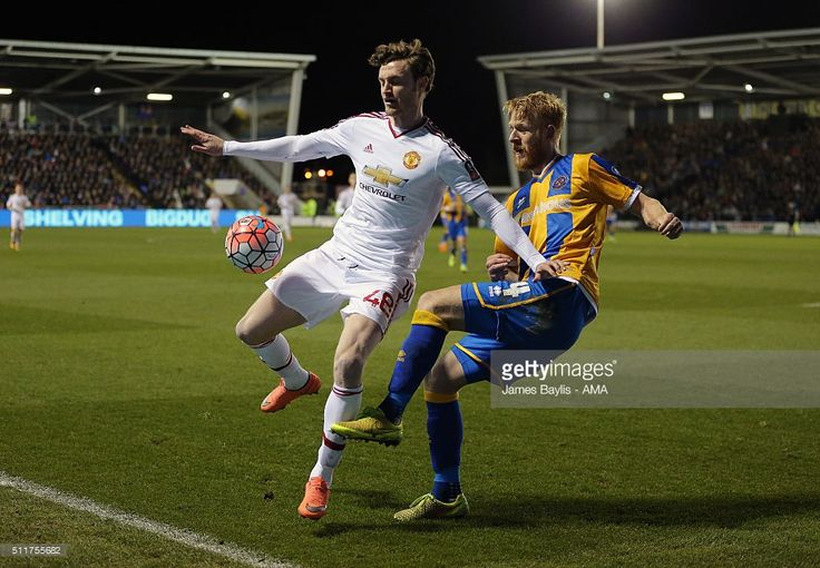 Will Keane of Manchester United and Zak Whitbread of Shrewsbury Town during the Emirates FA Cup match between Shrewsbury Town and Manchester United at New Meadow on February 22, 2016 in Shrewsbury, England.