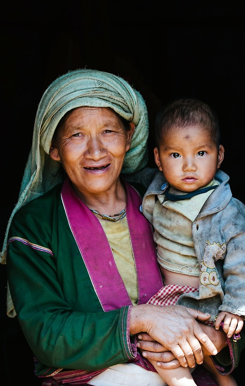 A older woman and her grandchild at a tea-farm in the hills of Shan State, Myanmar.  #portrait #travel #smile #burma #myanmar #photography