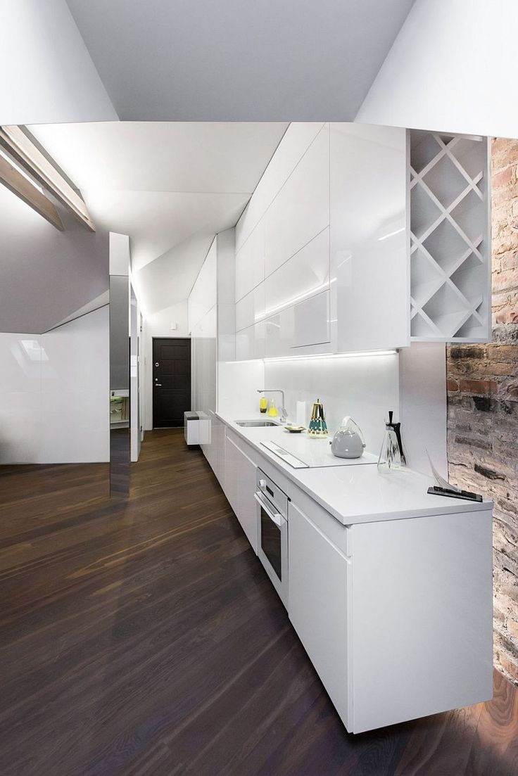 Sleek kitchen workdstation in white makes smart use of space - Decoist