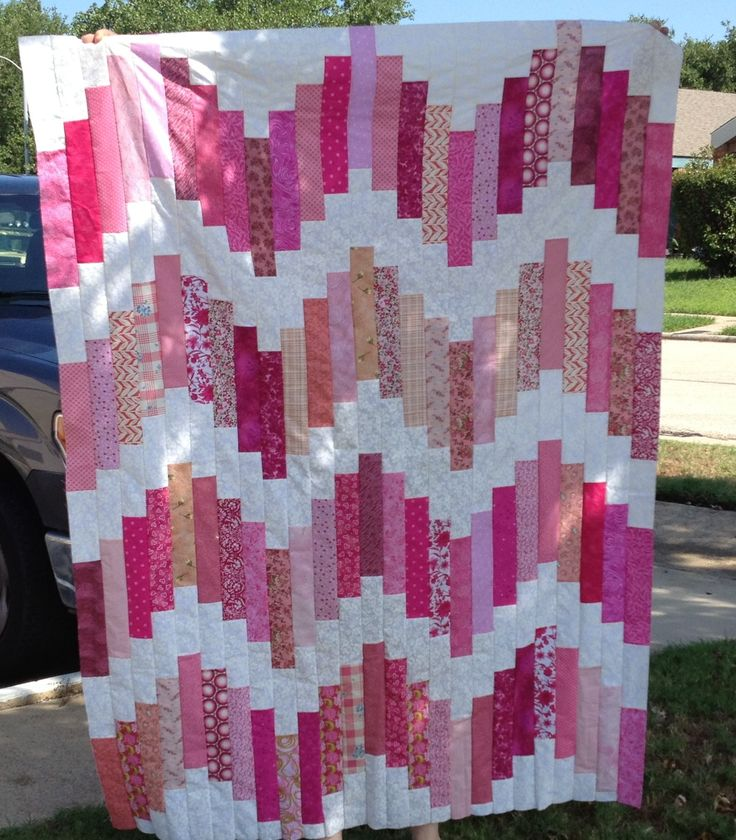 """Quilted by me. Pretty in Pink - Strawberry Hills. Pattern is Notting Hill by Joel Dewberry, adapted to use a jelly roll of main color and a jr jelly roll of base color. Pink strips cut to 11"""", center white strips 6.5"""", staggering white strips 2.5, 4.5, 6.5 & 8.5"""". Quilt pattern on Fatquartershop.com under Free Quilt Patterns in the Free Spirt category."""
