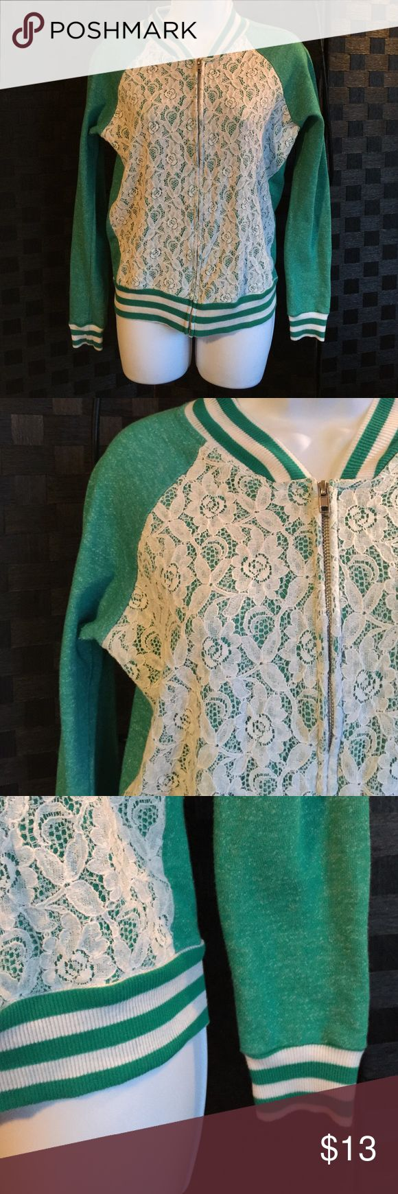 UNIQUE Lace Front Green Zip up jacket / Top CUTE! Washed & worn a few times~ in great condition! This is super cute, pretty green ~kind of unique in color & style! A women's/juniors size Medium ~With a pinch of stretch~ this is thinner (much thinner) sweatshirt like material -with a smoothness to it. A pretty Off white like lace front this zips up & has neat striped trimmings. A thinner top/ jacket like style. Super cute, made by True Freedom this is super soft, cozy & stylish!! Love this…