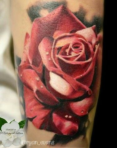 i love this rose tattoo, it looks so realistic but with a soft touch