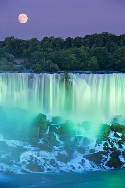 The American Falls with Full moon at dusk lit with lights photographed from Niagara Falls, Ontario, Canada visit us @ http://travel-buff.com/