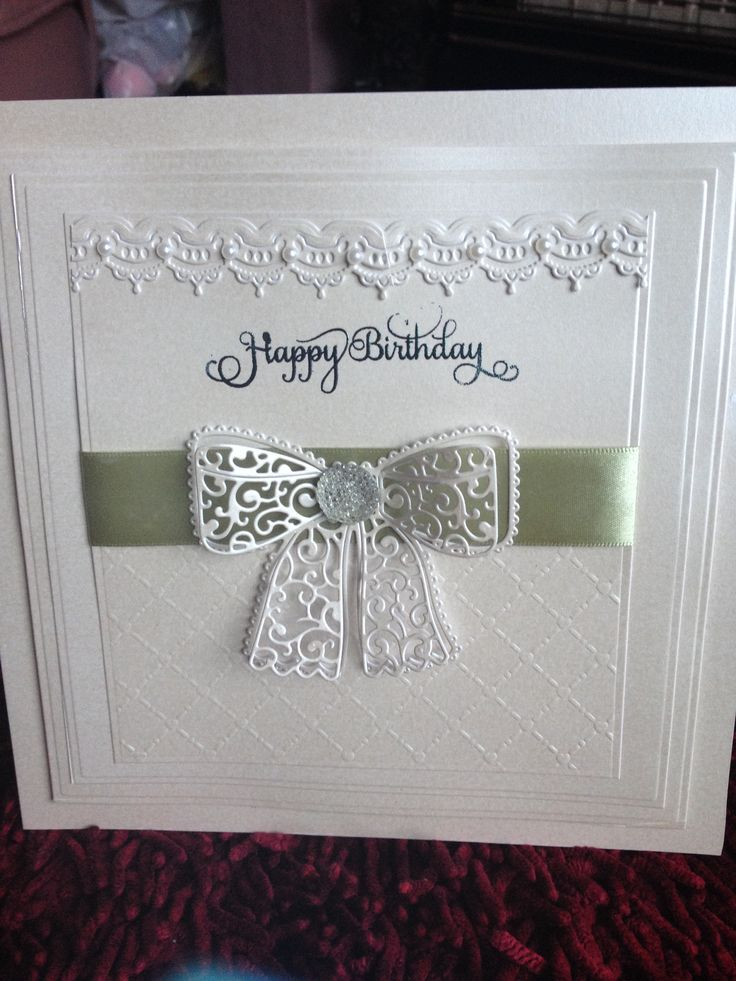 A card made using tattered lace now die