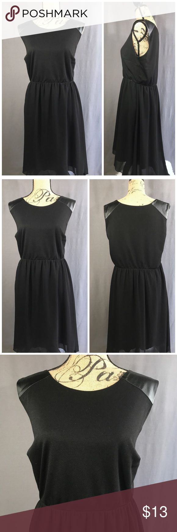 Black High-Low Dress with Chiffon Skirt & Leather Sweet Storm Black Dress with Chiffon high-low skirt overlay, and black faux leather epaulet detail. Fully lined, elastic hidden waistband, Sweet Storm Dresses High Low