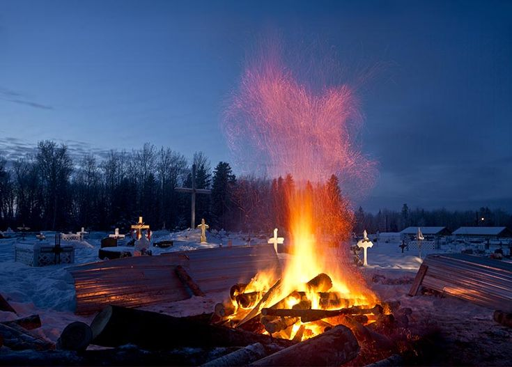 A fire burns in the cemetery in La Loche, SK to thaw the ground to prepare for the burial of the two brothers shot and killed last Friday. After three days of burning, volunteers will use shovels to dig the graves.  (Photograph by Chris Bolin)