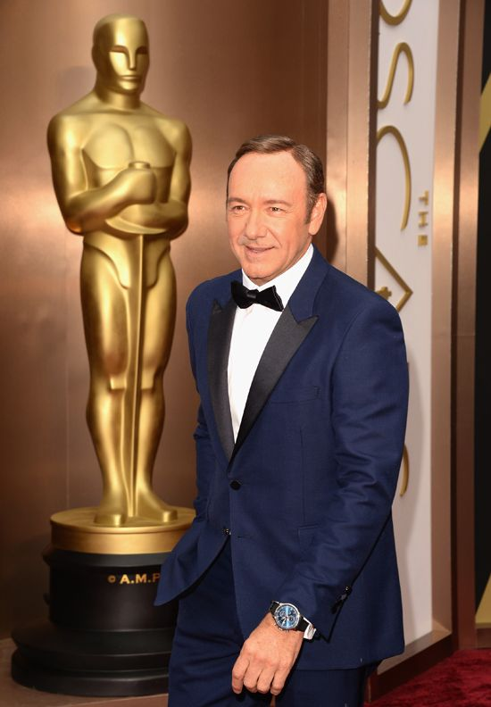 Kevin Spacey matched a midnight blue Burberry dinner jacket with a limited edition IWC Portuguese Yacht Club Chronograph featuring a dark bl...