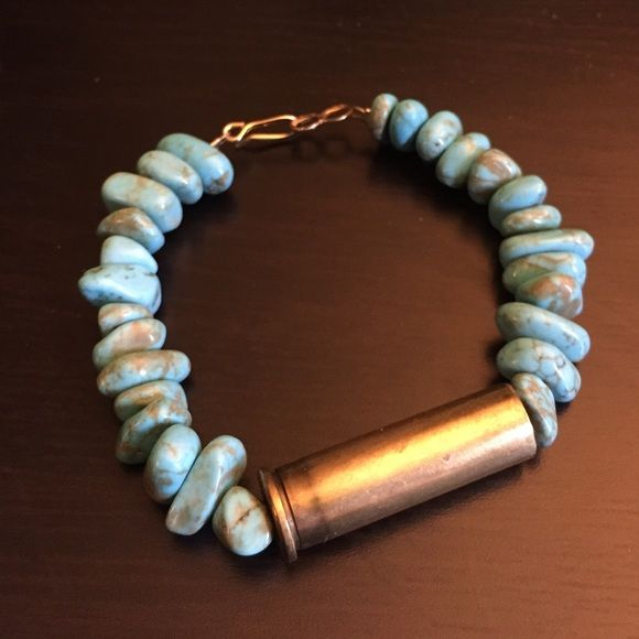 "Turquoise bracelet with brass bullet A gift from an ex that posh suggested I get rid of. Real turquoise bracelet with brass bullet casing and clasp. Would comfortably fit up to a 6.5"" wrist. Handmade Jewelry Bracelets"