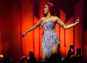 Cardi B has made rap history as her first three singles have landed in the Billboard Hot 100′s top 10 concurrently.. On Tuesday, Billboard announced that the Bronx-born artist achieved the feat on the Hot 100 chart with G-Easy's