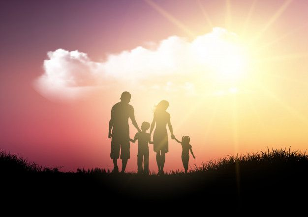 Download Silhouette Of A Family Walking Against A Sunset Sky For