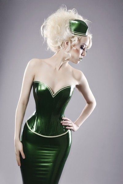 An emerald green latex corset with contrast edging design, by Ooh La Latex