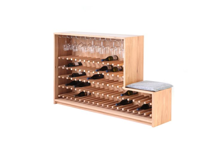 'Vino' is designed to store and display a wine connoisseur's coveted collection on a matrix of cantilevered dowels whilst keeping them close at hand and accessible.  The standard configuration has a storage capacity of 80 bottles and 20 glasses but this can be fully customised to any specification.   Incorporated into 'Vino' is a seat (with optional, upholstered cushion) which doubles as an additional display shelf. The piece is made from 100% Australian timbers (Blackbutt & Tasmanian Oak) i