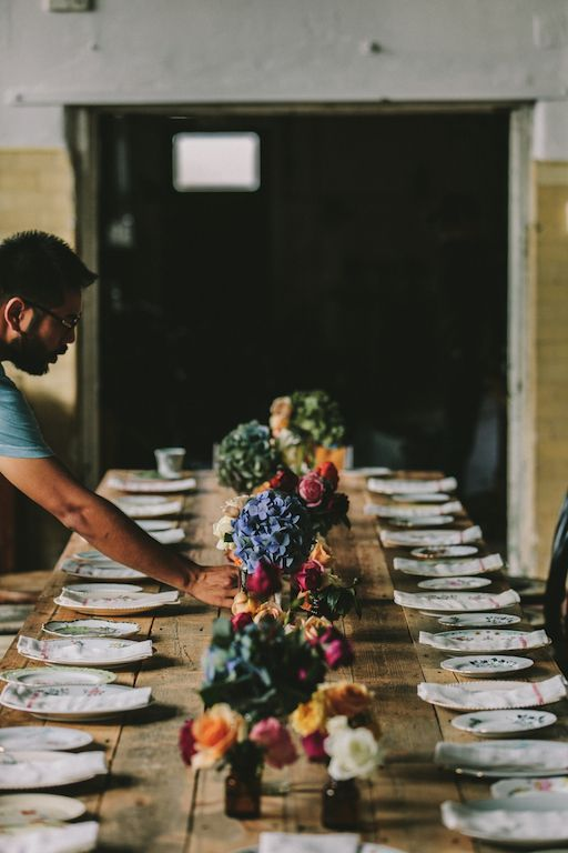 Rustic table setting with floral elements.