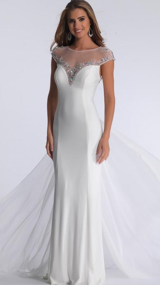 BB1107- In store now. A form fitting, bateau bodice dress with sheer fabric back. Modern bride this could the one for you! Ideal for the hourglass woman who wants to highlight her curves. The dress is adorned with a boat neck and sheer fabric from the short sleeves to the V-neck bust. Jewels outline the borders of the sleeves and bust. The dress is long and form fitting, and the back of the skirt is layered with chiffon