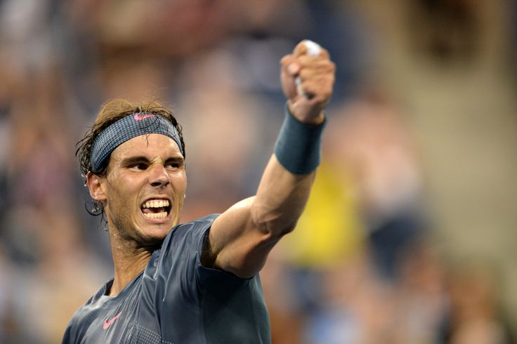 Rafael Nadal celebrates his 6-7, 6-4, 6-3, 6-1 victory over Philipp Kohlschreiber on Arthur Ashe Stadium. - Rob Loud/usopen.org
