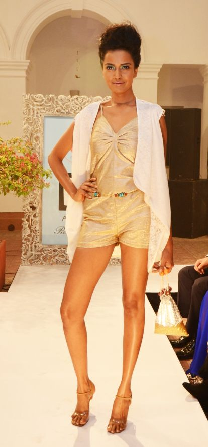 Copper shimmer-sea playsuit (INR 2990) worn with a white chiffon and Lurex-lace cowl jacket (INR 4090)
