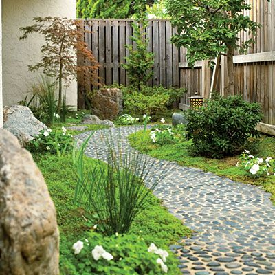 Pebbles are too smooth and round to make a suitable paving if left free to roll around. But when set in concrete with their flattest side up, they create a perfectly navigable path with an interesting texture.