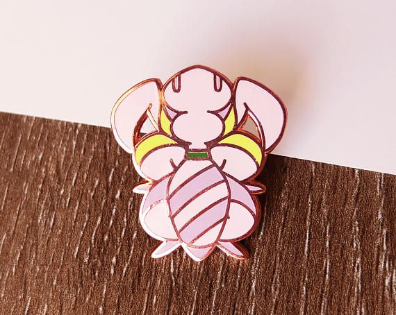This Copper Plated Orchid Mantis Hard Enamel Pin Is
