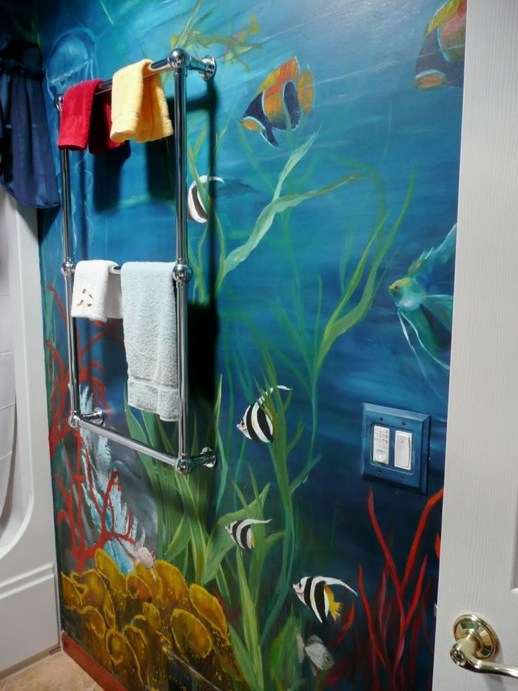 This is the main bathroom underwater mural painted by a professional painter/teacher in oils. A new Solatube with exhaust fan was installed recently to provide natural light where there is no window: