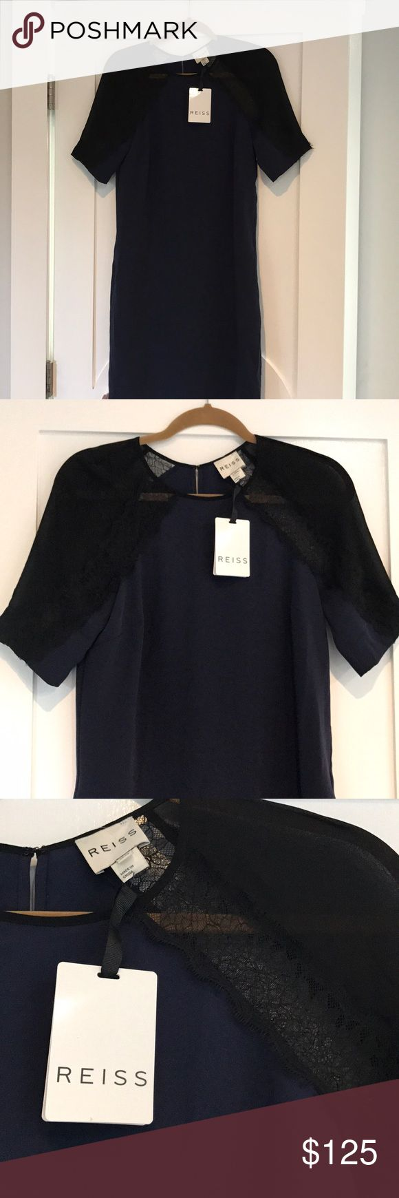 Reiss Lace Dress Beautiful Reese dress in a deep blue with black lace sleeves. The dress has pockets! Length is just below the knee. Size 4. Never worn with tags still attached showing original price of $295. (SK43) Reiss Dresses Midi