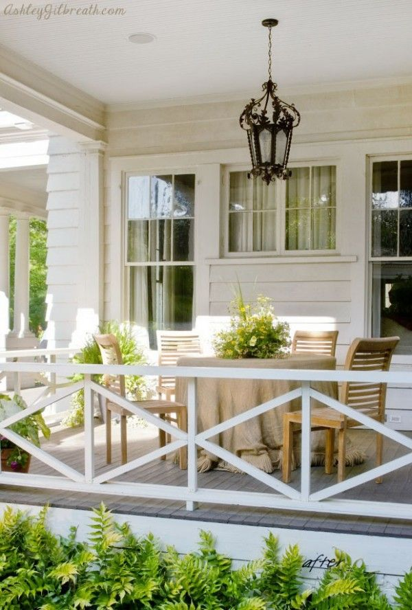 Wonderful side porch - elegant and calming with a green fern boarder and diamond rails! Ashley Gilbreath Interiors via The Lettered Cottage