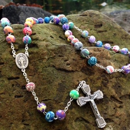 A beautiful 5 decades rosary with colourful flower motive beads $29.95 at Mary MacKillop Place Gift Shop.