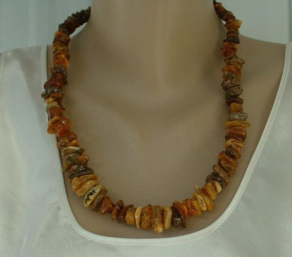 """• Main Color(s): brown, orange, misc • Materials: raw amber • Maker:unknown • Approximate Year: c2010 • Size: 23"""" This amber necklace has such interesting inclusions and such a variety of colors. It i"""
