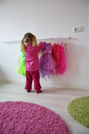 Curtain rod on the wall to hold all their dresses. Need this for our 3 beauties!!!