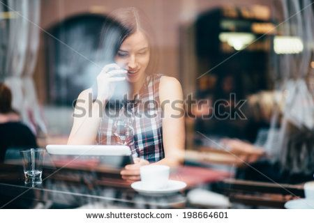 Young woman talking on the phone in coffee shop - stock photo