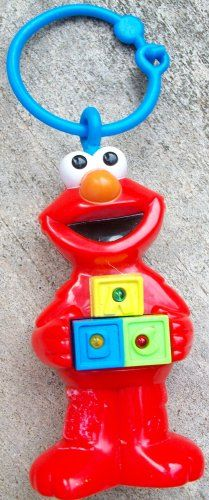 Sesame Street Elmo Musical Crib/car Seat/stroller Hanging Elmo Toy The Elmo Light Up Musical Toy stands about 6 inches high, he's made of hard plastic, formed into the shape of a standing Elmo. Plays a musical tune and has flashing lights. This toy can be used in the crib or on the go. It easily attaches to strollers, car seats or baby carriers. requires 2 AA batteries.