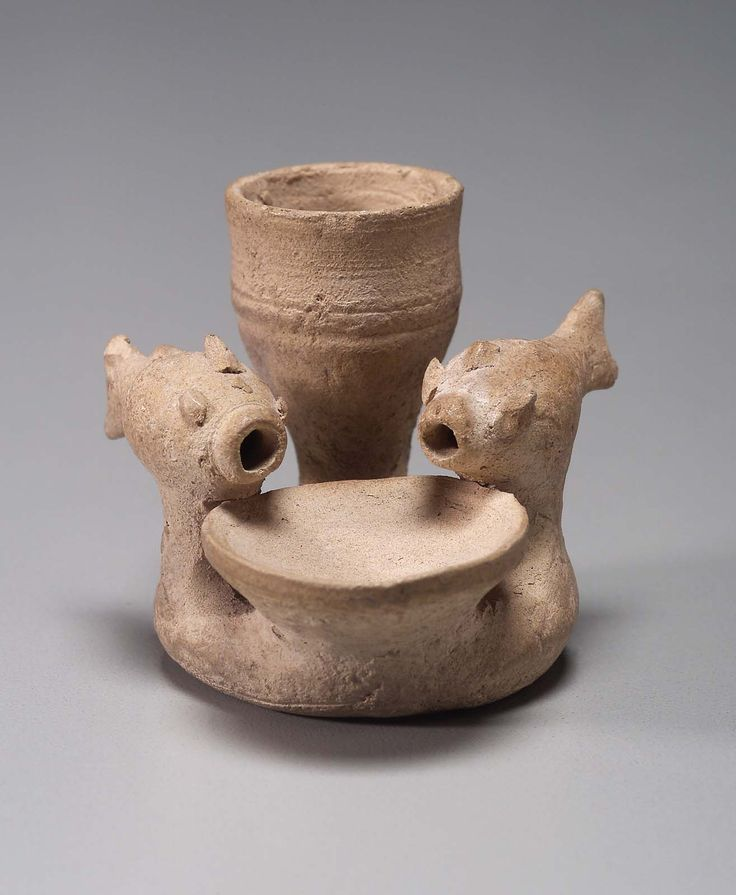 Miniature fish fountain, Pottery, Near Eastern, Mesopotamian, h: 3.5 cm (1 ⅜ in.) This object is a miniature fish fountain made of unglazed buff-colored clay. Several components share the same base: A central shallow bowl is flanked by two fish with modelled and applied details set on pedestals. Water was meant to flow from the mouths of two fish into the bowl. Not on view, Museum of Fine Arts, Boston, Massacusetts http://www.mfa.org/collections/object/miniature-fish-fountain-147802