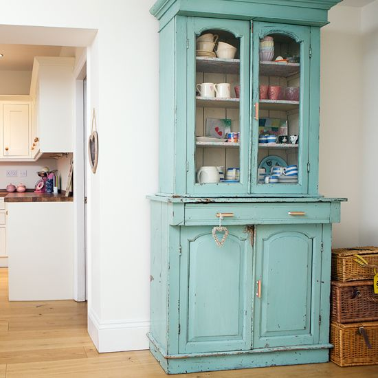 Kitchens: Country Kitchen with Vintage China also Wicker Hamper plus Wood Flooring and White Wall Cabinet