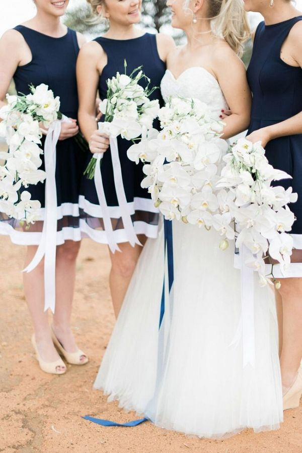 Navy Stripe Bridesmaid Dresses   Louise Vorster Photography on @SouthBoundBride via @aislesociety