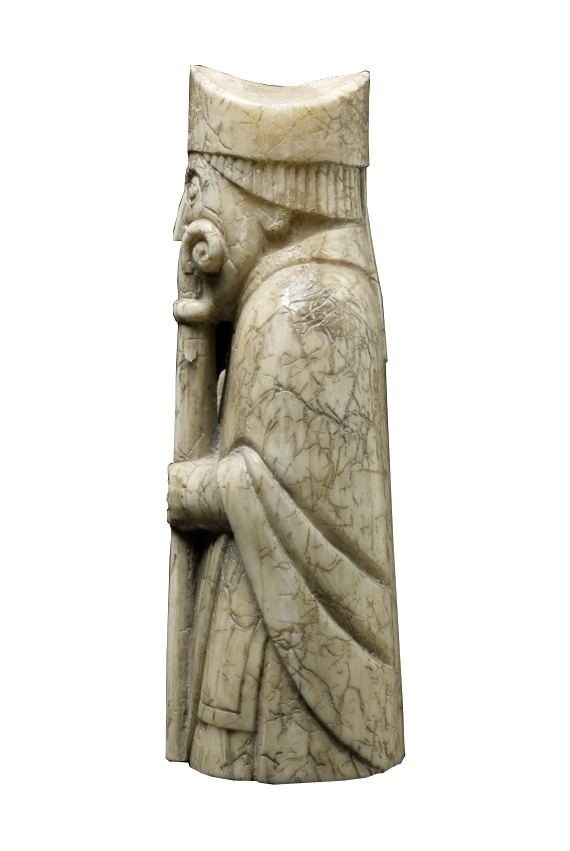 Lewis Chessmen Bishop: over his shoulders he wears a floor length cope - similar to those worn today by the clergy today.