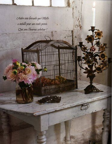 the birdcage would be empty, of course. I would not keep a bird in a cage...